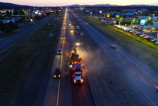 highway paving at twilight, poe asphalt